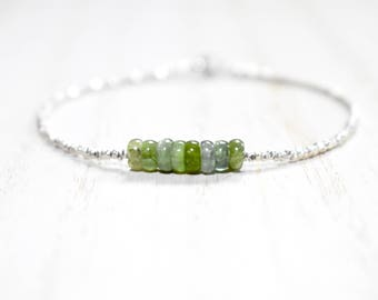 green tourmaline and sterling silver bracelet. tourmaline heshi slices and Thai sterling beaded bracelet. thin sterling silver bracelet