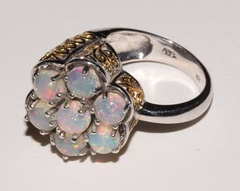 Genuine Ethiopian opal openwork flower ring set sterling silver with platinum and gold overlay, size 6 shipping incl within Can and U.S.A