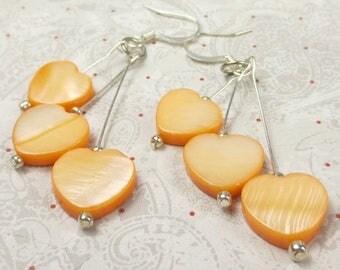 SALE, 50%, Orange Heart shell earrings that dangle in triples, halloween earrings, thanksgiving earrings, heart earrings, holiday earrings,