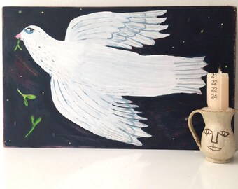 Flying dove painting on reclaimed wood.