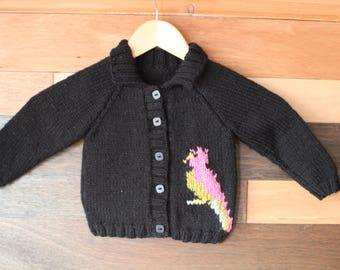 Hand knit childs cardigan with parrot motif  1 - 2 years.