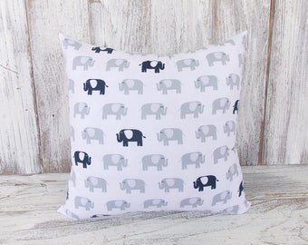 Throw cushion with grey and navy elephants on a white background - for home decor, nurseries, shower gift