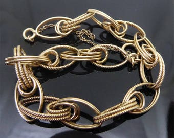 14K Gold Gorgeous Dual Textured Charm Bracelet - 10.4 Grams Interesting Links