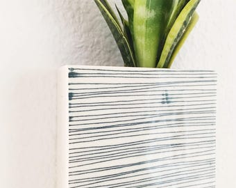 small porcelain planter / wall vase screenprinted lines pattern in blue.