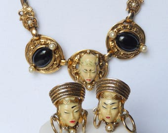 Unsigned Selini and or Selro exotic face necklace and clip on earrings