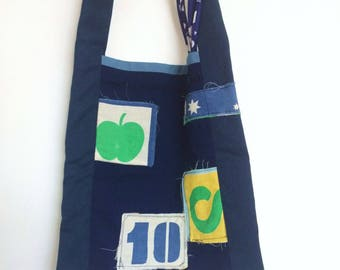 Tote bag with vintage patches and upcycled fabric