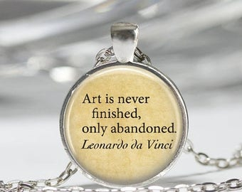 ON SALE Leonardo Da Vinci Necklace Quote Art Is Never Finished Only Abandoned Art Pendant in Bronze or Silver with Link Chain Included