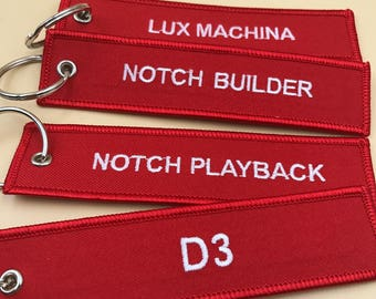100 remove before flight keychain, aircraft keychain, embroidered keychain, airplane key chain