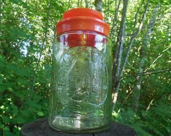 Collectible Anchor Hocking Tang Jar with Orange Lid, Cabin Design Tang Jar / Bottle, Decorative Storage Jar, Glass Canister Jar, Vintage
