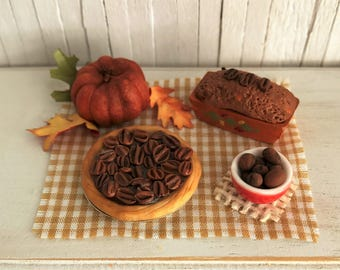 Miniature Pecan Pie, A Bowl of Pecans, and a Pumpkin Loaf In Hand Painted Loaf Pan