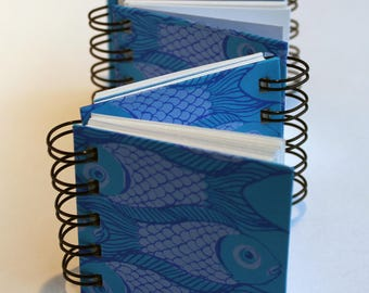 Ring bound zigzag book with fish design and box