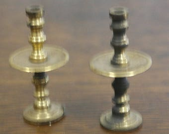 antique small size pair of unusual beass candle sticks