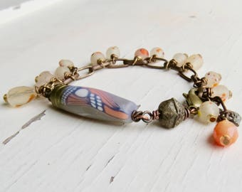 Mariposa - handmade artisan bead bracelet in pale orange, charcoal and cream with butterfly focal, glass and carnelian - Songbead, UK