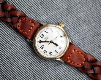 Vintage Timex quartz watch ladies size with braided leather strap