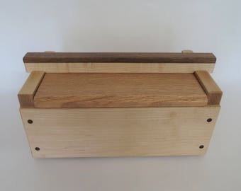 Wooden box from maple, walnut, and oak