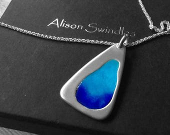 Solid silver pendant with shades of blue enamel