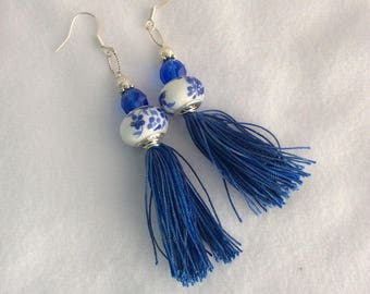 White with blue floral design Lampwork glass bead, silver bead, spacer, blue Czech crystal with blue tassel earrings - Sale