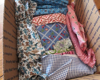 box of vintage fabric pieces