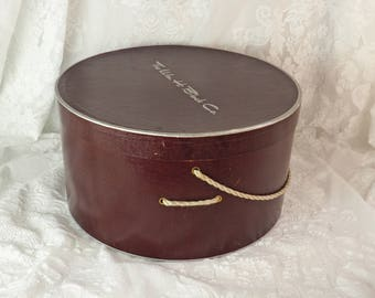 Antique Hat Box- Brown/ burgundy- Large Round Box with lid and carry rope handle- The Wm. H. Block Company