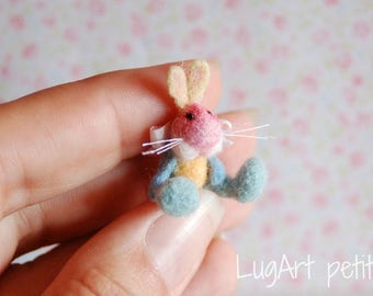 Colorful needle felted bunny.