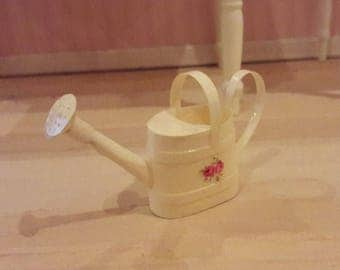 Light yellow watering can to your dollhouse
