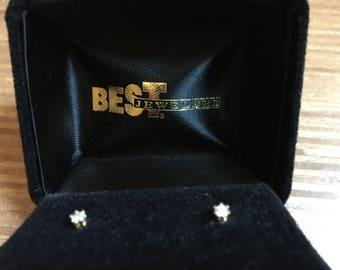 Tiny Diamond post earrings.