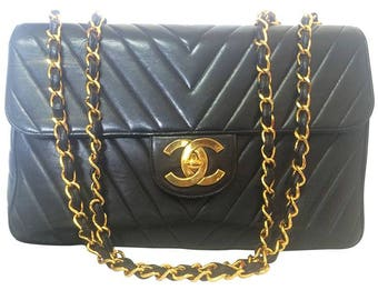Vintage CHANEL black lambskin classic jumbo, extra large 2.55 black shoulder bag with chevron stitch. Rare masterpiece