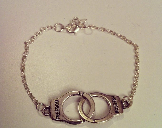 Silver plated chain with small handcuff bracelet