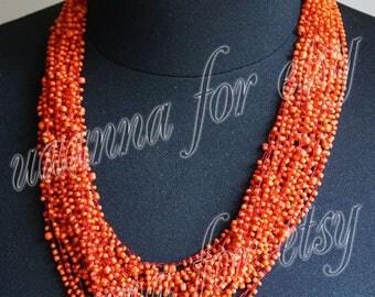 Necklace handmade beaded orange. Technique crochet.
