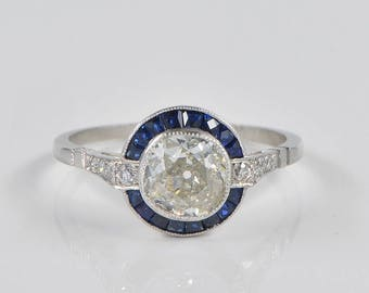 Exquisite Art Deco 1.10 Ct diamond plus platinum target ring