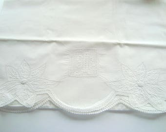 Vintage embroidered white on white pillowcase