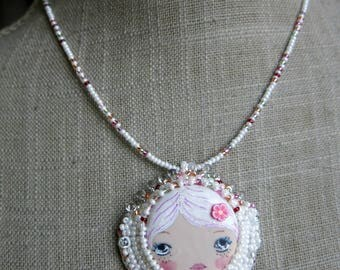 Embroidered face necklace