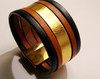 Navy blue leather cuff Tan and gold with lobster clasp gold