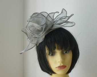 Silver flower inspired Fascinator for weddings, Races or Melbourne Cup
