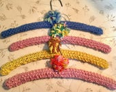 Vintage Crocheted Hangers (4). Pink, Yellow, Blue, with PomPoms.