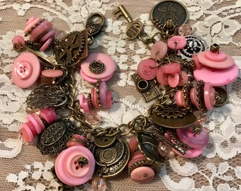 Chunky Bracelet Loaded with Buttons And Charms .   Antique Bronze Tone Chain Link Bracelet With Pink Buttons.