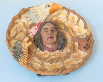 Collector Plate, Sculptured Indian head, wolf, deer, eagle. 8 1/2 Inch