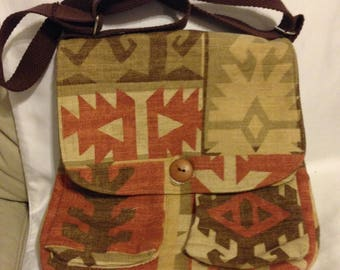Cross body bag with pockets inside and out