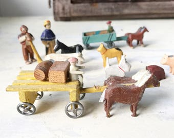 A lovely collection of vintage Putz German miniature farm animals and people