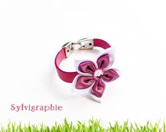 Leather strap and pink satin flower