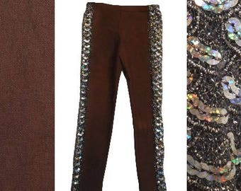 BROWN STRETCH TOREADOR PANTS AND BLACK LACE