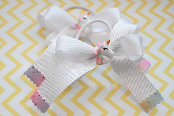Pair of white unicorn rainbow bows / hair ties / pigtail bows / pony tail bows / flowergirl bows / birthday bows