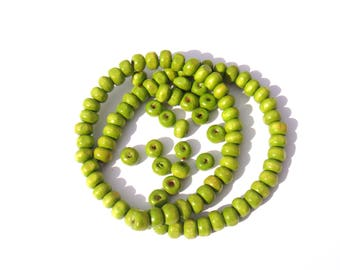 100 irregular wooden beads dyed lime green 5 mm x 6 mm in diameter approx