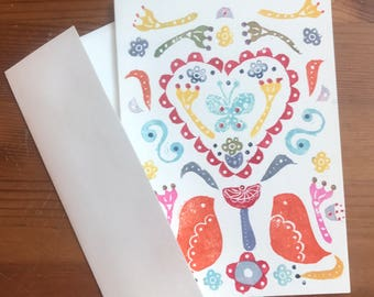 Handprinted Valentine's Day card with love birds and heart
