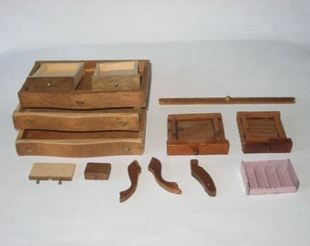 Dollhouse assorted wooden drawers (10) - 3 odd table legs - and 1 metal Tootsie Toy piece.