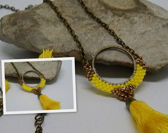 Woven yellow and bronze pendant