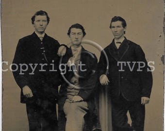 Tintype Photograph Stiff and Uncomfortable Man posed with Friends