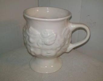 Cherub Pedestal Mug