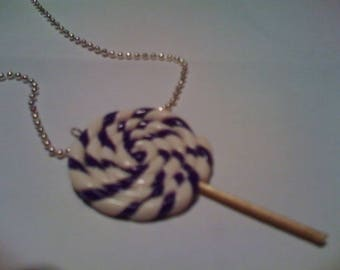 PURPLE LOLLIPOP AND WHITE POLYMER CLAY
