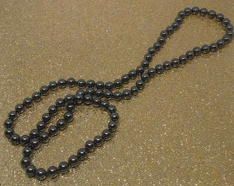 Vintage, Handmade , knotted,  hematite beads, silk cord long necklace  with a matching pair of stud earrings